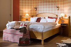 Hotel room furniture in country house style